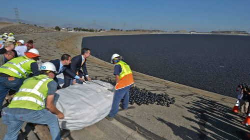 Council member Mitch Englander and LA Mayor Eric Garcetti along with LADWP workers releasing shade balls into the LA Reservoir Los Angeles Department of Power and Water